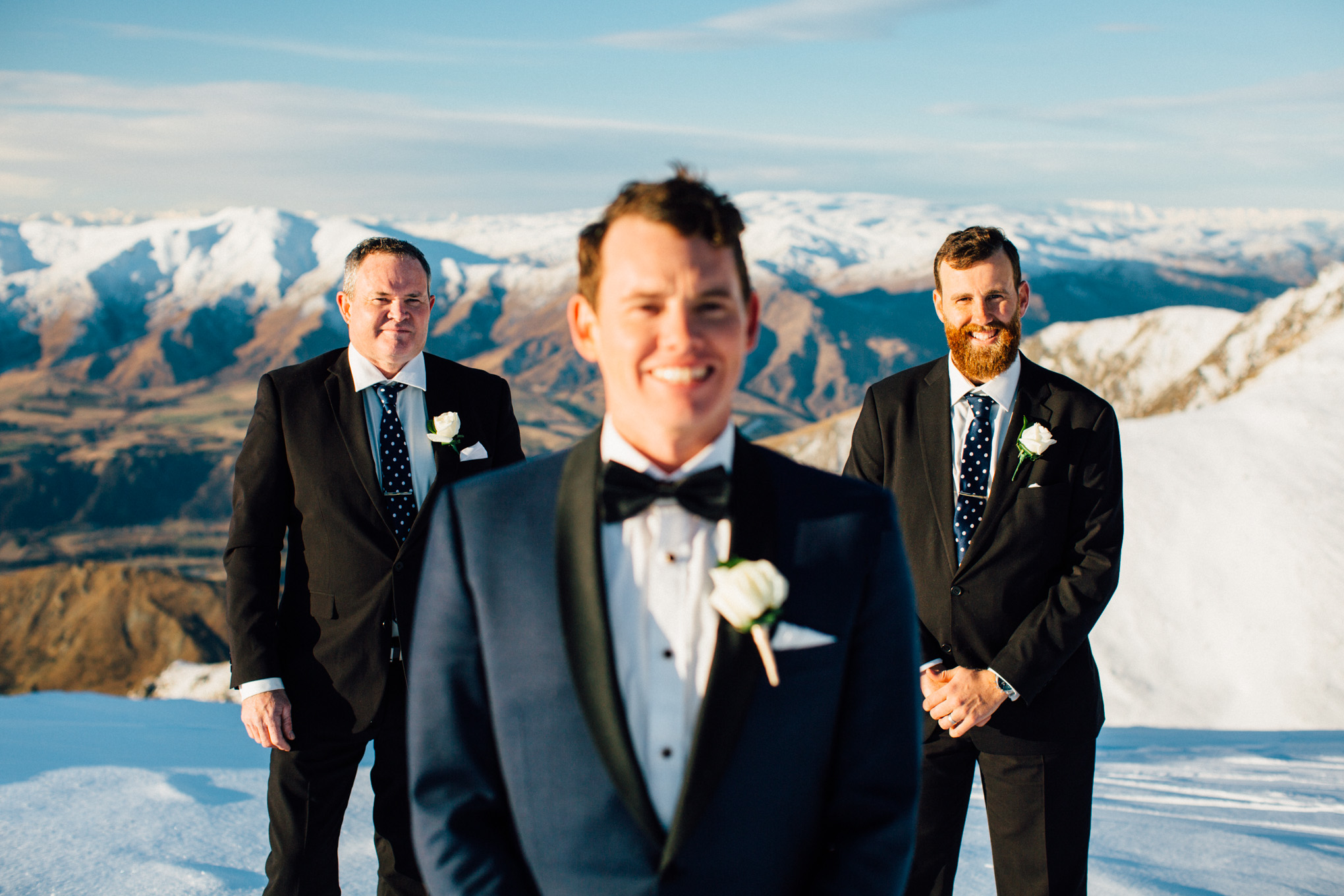 groomsmen snow wedding