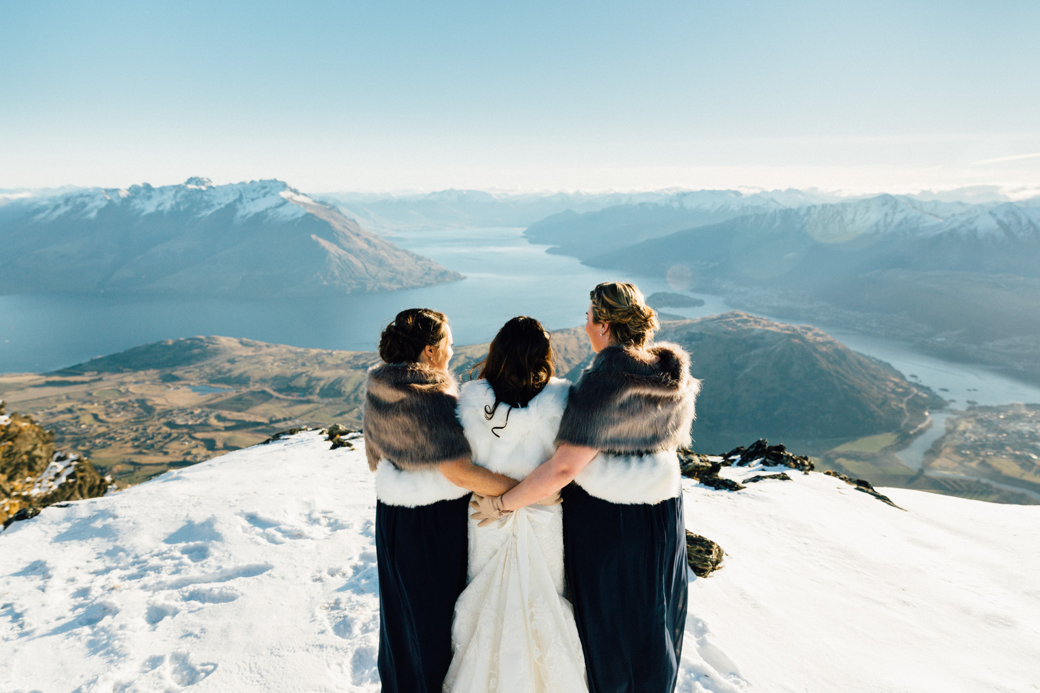 bridesmaid and bride snow wedding